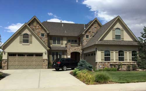 Remodeld Home Exterior Featuring Stucco and Stone Siding, New Windows and Doors and New Roof by Mountain View Corporation in Colorado